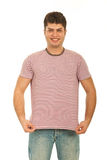Happy guy showing blank t-shirt Stock Images