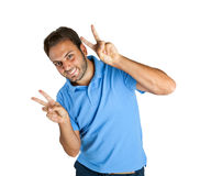Happy guy shows Victory Stock Images