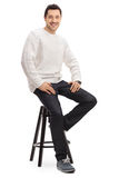 Happy guy sitting on a chair Royalty Free Stock Photo