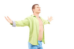 Happy guy spreading arms Stock Image