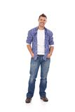 Happy guy standing with hands in pockets Royalty Free Stock Photo