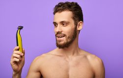 Happy guy starts a new day with a new razor. stock photo