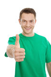 Happy guy thumbs up in green t-shirt. Royalty Free Stock Images