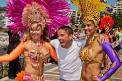 Happy guy with two hot Brazilian dancers Royalty Free Stock Photo