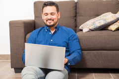 Happy guy working from home on a laptop Royalty Free Stock Images