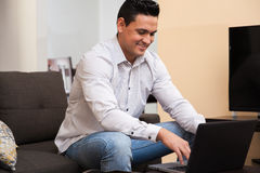 Happy guy working from home Stock Photography