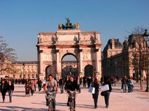 Happy guys on bicycle around Louvre, Paris Royalty Free Stock Photo