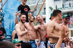 Happy guys at gay pride parade in Sitges Stock Images