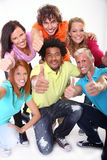 Happy guys and girls expressing happiness Stock Images
