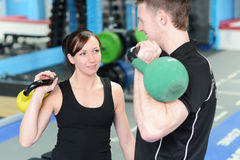 Happy gym workout with personal trainer royalty free stock photography