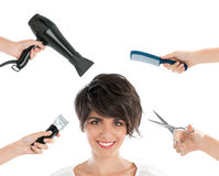 Happy hairdresser. Happy smiling young woman with hairdresser tools among her isolated on white background royalty free stock photography