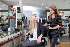 Happy Hairdresser with Customer Stock Photos