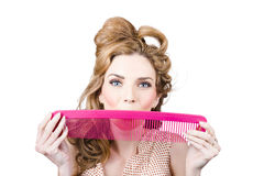 Happy hairstyle Pinup woman smiling with hair comb Royalty Free Stock Image