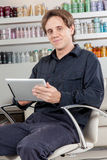 Happy hairstylist looking the camera Stock Images