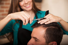 Happy hairstylist at work Royalty Free Stock Photography