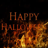 Happy Halloween. 'Happy Halloween' on fire, set on a black background Royalty Free Stock Photos