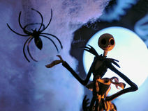 Happy halloween. Jack Skeleton with dog and spider in front of moon royalty free stock photo