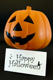 Happy Halloween. Card and pumpkin on black background Royalty Free Stock Images