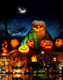 Happy Halloween. Image with lots of glowing jackolanterns in fantastical spooky environment Stock Photos