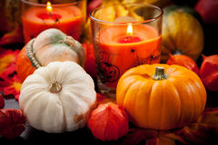 Happy Halloween. Pumpkins and candles still life