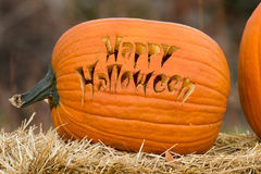 Happy Halloween. Carved pumpkin with Happy Halloween text Royalty Free Stock Photo