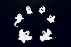 Happy Halloween background with frame of ghost cut out of paper. Royalty Free Stock Photos