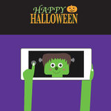 Happy Halloween background with smartphone and little monster Royalty Free Stock Photo
