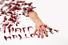 Happy halloween. Bloody cut hand and Happy halloween written with red human blood on white background Stock Photography