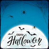 Happy Halloween on blue grunge background with spiders and bats Stock Photo