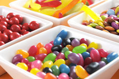 Happy Halloween candy in square white bowls closeup. Stock Images