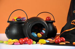 Happy Halloween candy in trick or treat carry cauldrons with witches hat Stock Photos