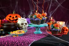 Halloween candyland drip cake style cupcakes in party table setting. Royalty Free Stock Images