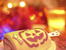 Happy Halloween! Celebration party with pumpkin cake and drink!T. On the night of the Halloween party toast a drink and a roll cake with a pumpkin illustration Royalty Free Stock Photos