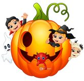 Happy Halloween character in the big pumpkin Royalty Free Stock Photography