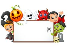 Happy Halloween character holding blank sign Stock Photos