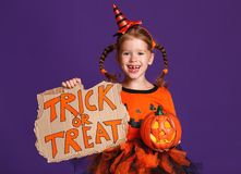 Happy Halloween! cheerful child girl in costume with pumpkins on royalty free stock photos