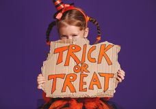 Happy Halloween! cheerful child girl in costume with pumpkins on royalty free stock images