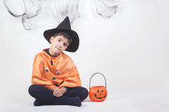 Happy halloween. Child dressed as a pumpkin for Halloween Royalty Free Stock Photos