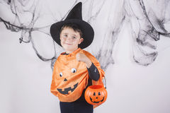 Happy halloween. Child dressed as a pumpkin for Halloween Royalty Free Stock Image