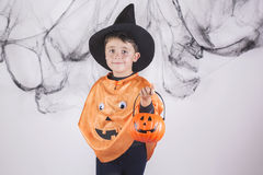 Happy halloween. Child dressed as a pumpkin for Halloween Stock Images