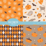 Happy Halloween collection. Set of seamless vector patterns with traditional holiday symbols: pumpkins, ghosts, spiders, bats in orange and brown colors Royalty Free Stock Photography