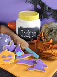 Happy Halloween cookies, jar, rolling pin and cutters - vertical. Royalty Free Stock Images