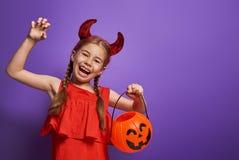 Little devil with a pumpkin Stock Photo
