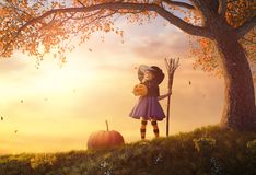 Child in witch costume Stock Images