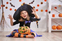 Girl in witch costume Stock Image