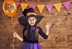 Little witch with a pumpkin stock image