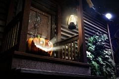 Happy Halloween. 3D illustration of pumpkin on the doorsteps of the old house Royalty Free Stock Images