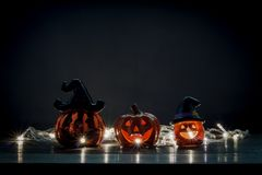 Happy Halloween decorations festival concept. Mix variety objects on the modern rustic wood at home office desk.Essential accessories on the dark tone with stock image