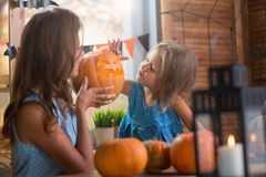 Happy Halloween. Family little beautiful girl with mother celebrating home with pumpkins royalty free stock photography