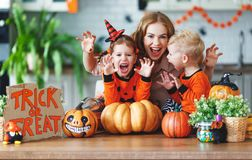 Happy Halloween! family mother and children getting ready for ho. Liday cutting a pumpkin stock photo